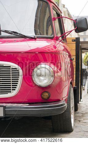 Retro Pink Car Close Up. Beautiful Retro Pink Car Close Up On City Background Close Up