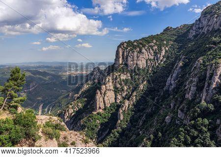 View Of Mountains And Plains Surrounding Abbey Of Montserrat (santa Maria De Montserrat) In Cataloni