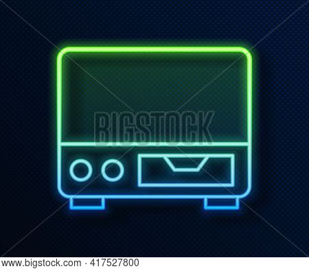 Glowing Neon Line Old Video Cassette Player Icon Isolated On Blue Background. Old Beautiful Retro Hi