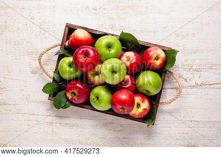 Ripe Red And Green Apples In Wooden Box.top View With Copy Space.