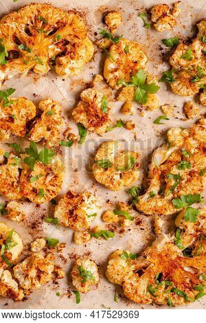 Cauliflower Steak With Spices Cooked In The Oven, Top View. Vegetable Meat Substitute.