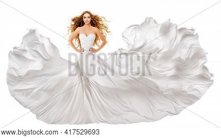 Woman White Long Dress. Red Hair Model In Wedding Gown. White Silk Fabric Waving On Wind. Curly Redh