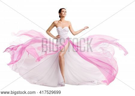 Woman White Pink Dress Flying On Wind. Fashion Model In Chiffon Long Slit Bride Gown Over White Isol