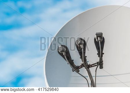 Feedhorn Of A Satellite Dish Against A Blue Sky, Close-up.
