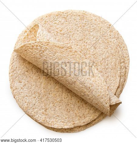 Rolled Up Tortilla On Top Of A Stack Of Plain Spelt And Oat Tortilla Wraps Isolated On White. Top Vi