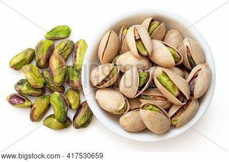 Salted Pistachios In Shell In A White Ceramic Bowl Next To Shelled Salted Pistachios Isolated On Whi