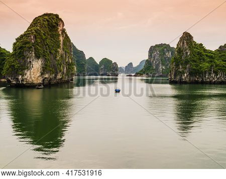 Stunning View Of Halong Bay Karst Formations Reflected In The Emerald Waters Of Tonkin Gulf, Vietnam