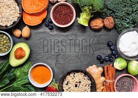 Set Of Healthy Food Ingredients. Top View Top Frame On A Slate Background. Copy Space. Super Food Co
