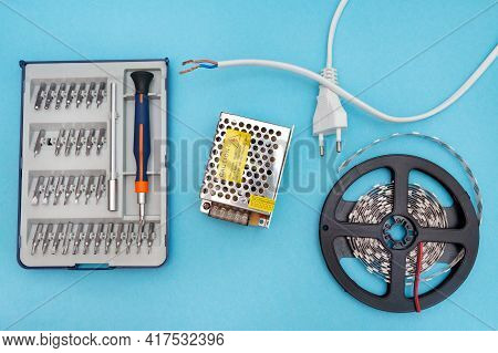Power Supply For Led Strip. A Set Of Tools For Connecting An Led Strip, A Screwdriver, A Plug For Th