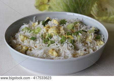 Steamed Basmati Rice With Scrambled Eggs And Spring Onions. Popular Food From North India Known As E