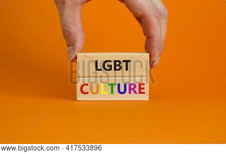 Lgbt Culture Symbol. Wooden Blocks With Words 'lgbt Culture' On Beautiful Orange Background. Gay Han