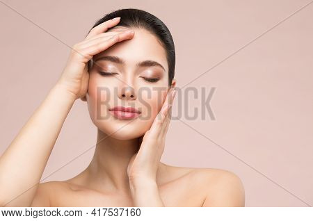 Beautiful Woman Face Skin Care. Natural Make Up. Skin Health Treatment. Model Massaging Face By Hand