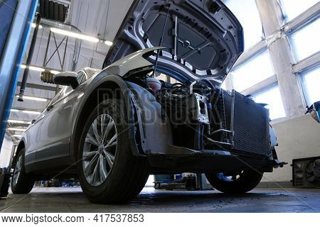 Moscow Russia - April 18 2021: Car In A Car Service Under Repair. The Hood Is Open On The Car And Th
