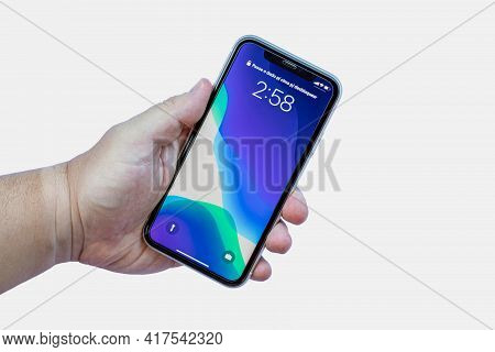Rio De Janeiro, Brazil - April 19, 2021: Hand Holding An Iphone 11 Connected From The Front On White
