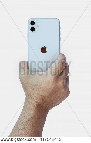 Rio De Janeiro, Brazil - April 19, 2021: Hand Holding An Iphone 11 From The Back On White Background