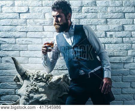 Man Drink Whiskey. Degustation, Tasting. Man With Beard Holds Glass Of Brandy. Bearded Businessman I