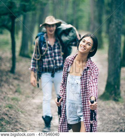 Couple Hiking With Overnight Stay Or Picnic. Tourists Concept. Couple With Touristic Equipment.