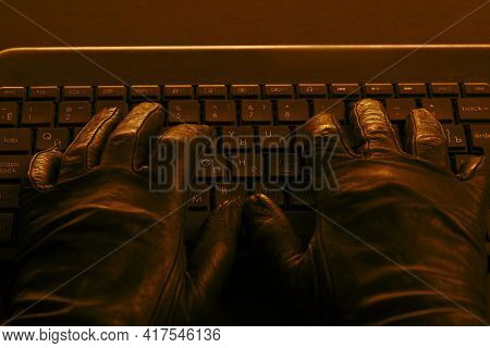 Hacker's Hands On Laptop Keyboard. Hacking A Security System. Hacker In Gloves