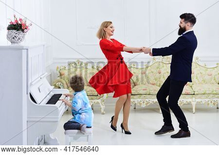 Parents Enjoy Parenthood. Piano School Concept. Kid Son Play Piano Musical Instrument, While Parents