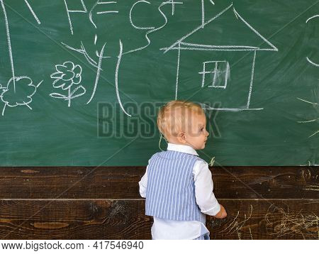Pupil Kid Painting Doodle On Classroom Chalkboard. Little Artist Boy Creating Picture On School Day.