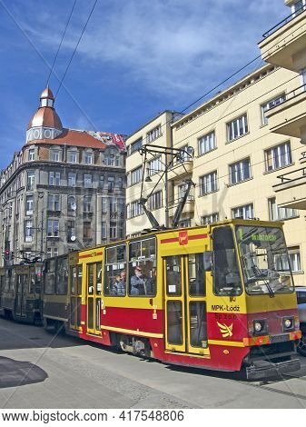 Lodz - Poland. 18 April 2019: Modern Tram Riding Around City. Red Tram Going On City Street In Lodz.