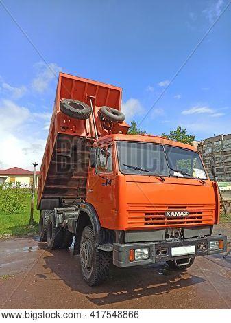 Chernihiv - Ukraine. 06 June 2020: Dump Truck Kamaz Is Standing With Body Raised. Truck For Transpor