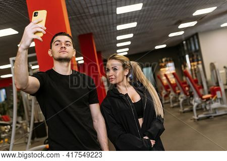 Personal Trainings With A Trainer. Physical Trainer And Woman Take A Selfie In The Gym