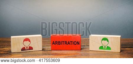 Wooden Blocks With The Image Of Two People And The Word Arbitration Between Them. Alternative Disput
