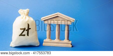 Polish Zloty Money Bag And Government Building. Business And Finance Concept. Deposit, Loan And Inve