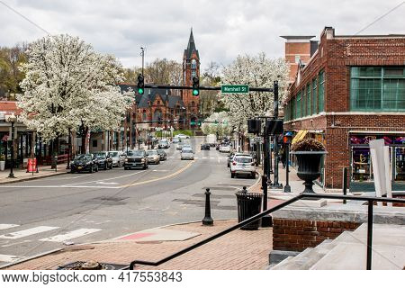 NORWALK, CT,USA  - APRIL 16, 2021:  View from North Main Street in spring day with blooming trees