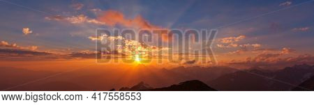 Scenic Sunset in the mountains. Beautiful natural background.