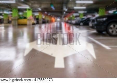 Car Parking Blurred. Empty Road Asphalt Background In Soft Focus. Car Lot Parking Space In Undergrou