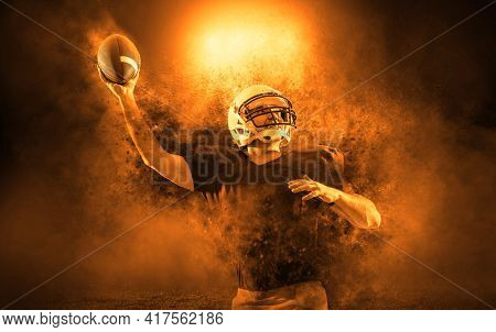 American football sportsman player with ball in action on stadium under lights background. Sport, proud footballer in white helmet and red shirt ready to play.