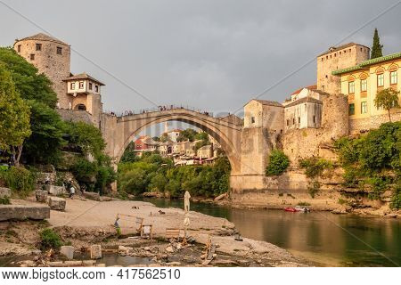 Mostar, BiH - August 31, 2019: Stari Most bridge at sunset in old town of Mostar, Bosnia and Herzegovina.