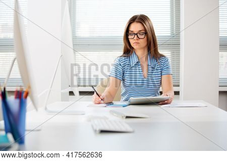Portrait of a happy female student works in a computer class