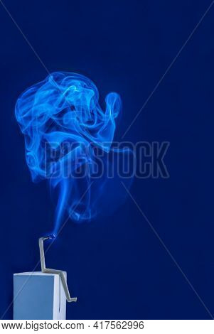 matchstick as a figure with smoke. as a symbolic photo for burno