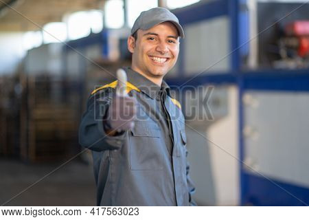 Smiling mechanical worker giving thumbs up
