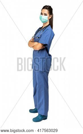 Nurse portrait isolated on white, full length wearing a mask due to coronavirus covid 19 pandemic