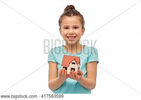 mortgage, real estate and accommodation concept - smiling girl holding house model over white background