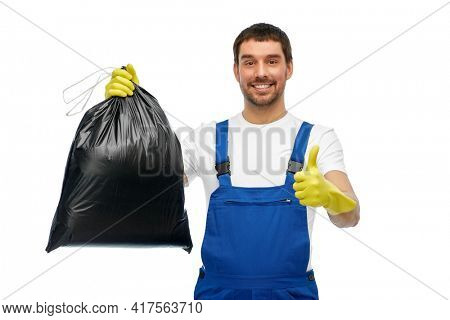 profession, cleaning service and people concept - happy smiling male worker or cleaner in overall and gloves showing garbage bag showing thumbs up over white background