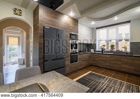 Modern luxurious dark brown, gray and black kitchen interior