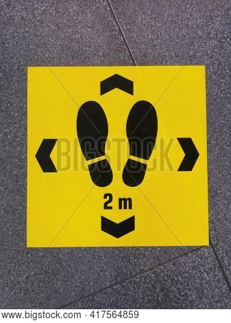 Keep Distance Sign Printed On The Floor, Safety Sticker On Ground During Coronavirus Covid-19 Outbre