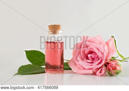 A Glass Jar With A Pink Rose. Cosmetics And Perfume. Scented Rose Water In A Glass Bottle, Roses. Fl