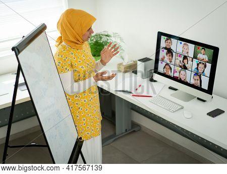 Arabic female teacher working with children online school during pandemic