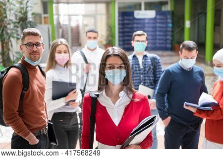 students group at university walking and wearing face mask