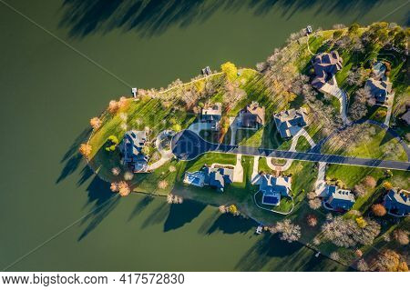 Top-down view of a residential neighborhood by a lake near Georgetown in Central Kentucky
