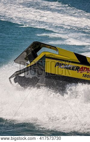 Airlie Beach, Queensland, Australia - April 2021: The Back Of A Jet Boat As It Spins In The Water Gi