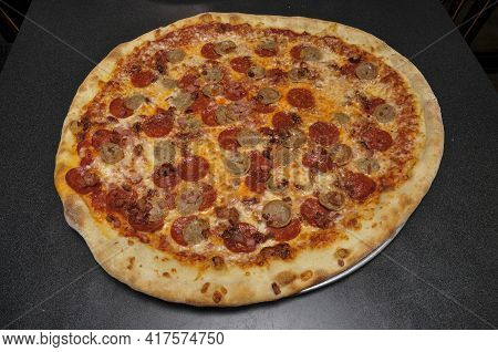 Delicious Tomato Sauce Cheese Covered Hot And Tasty Meat Lovers Pizza Pie