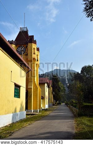 Church With Red Roof And Clock Tower .