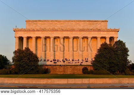 Washington, Dc - Apr 3, 2021: Lincoln Memorial From The Rear With Spectators Enjoying The Sunset In